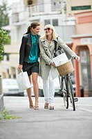 Two women walking with shopping bags (thumbnail)