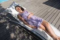 High angle view of a woman resting on a deck chair