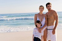 Family standing on the beach (thumbnail)