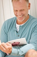 Man reading a magazine and smiling