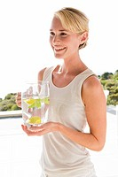 Woman holding a jug of lemonade and smiling