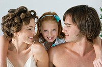 Close_up of a couple smiling with their daughter