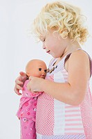 Girl hugging a doll