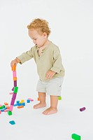 Baby boy playing with blocks