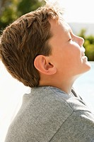 Close_up of a boy day dreaming