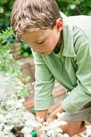 Close_up of a boy gardening