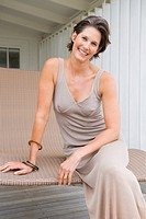 Woman sitting on a porch swing and smiling