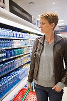 Woman buying water bottle in a store