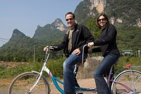 Moon Hill, Yangshuo, China, Couple on tandem bike