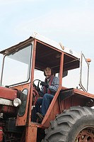 Female farmer in tractor