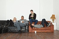 Young people on leather sofa