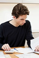 Young man doing paperwork