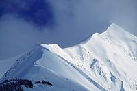 Snow cornice leading up to mountain peak