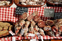 Stock photo of a French market stall with cured sausages and cuts of filet mignon  The photo was taken in the Limousin region of france