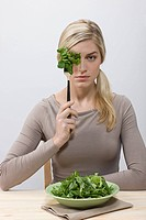 Woman with forkful of lettuce