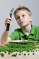 Boy looking at pea