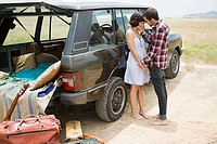 Young couple by suv