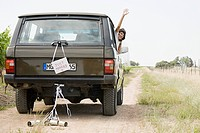 Newlywed woman waving from vehicle