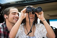 Young couple with binoculars