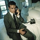 Young Man in Suit on the Phone