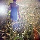 Teenage girl walking in corn field, Bavaria, Germany