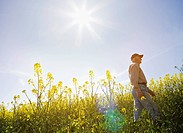 Farmer walking through field