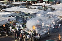 High view of food stalls, cooking and people in Djemma el Fna square in early evening in the Medina, Marrakech, Morocco, North Africa, Africa