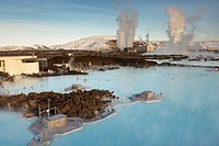 People relaxing in Blue Lagoon geothermal spa, Svartsengi Geothermal Power Station in the distance, Grindavik, Reykjanes Peninsula, Iceland, Polar Reg...