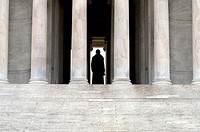 detail of the steps and columns of the Jefferson Memorial, showing silhouette of the statue of Thomas Jefferson
