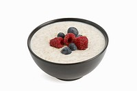 Bowl of Porridge with raspberries and blueberries