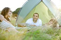 Three young men camping