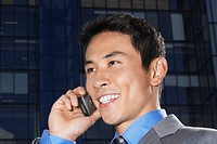Smiling Businessman Using Cell Phone close_up