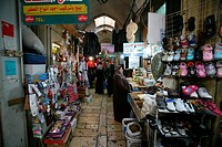 Shoppers at a shoe stand in a market in the old city section of Jerusalem