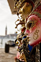 Carnival mask with the silhouette of the Campanile in the background, Venice, Italy, Europe