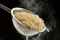 Italian cuisine: cooked pasta in a strainer