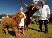 Award winning Highland cow breeder, Ronnie Shepherd with Prize cow Reserve champion Highland accompanied by his grand daughter Emma Gillespie aged 7 w...