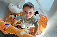 Baby boy in playpen (thumbnail)