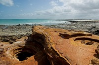 Red and black rocks at the shore, Gantheaume Point, Broome, Western Australia, Australia