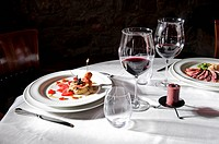 Table setting with food and wine (thumbnail)