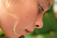 Close_up of a girl looking down