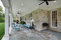 Bluestone patio with columns and blue furniture