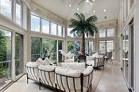 Porch in luxury home with wall of windows