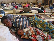A malnourished mother and child resting in a feeding centre  Feeding centres and other humanitarian aid were organised in Angola after widescale malnu...