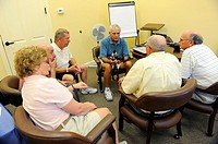 People meet in small group to discuss matter of importance