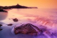 sunrise on a rocky shore in Sardinia, Italy