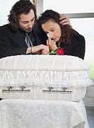couple grieving at infant´s coffin