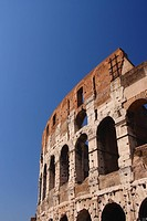 The Roman Colosseum viewed from the outside against a strong and clear blue sky
