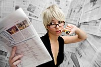 woman in room with newspaper wallpaper