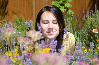 portrait of a girl smelling wildflowers