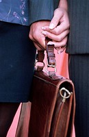 Briefcase in the hand of a Man and Woman